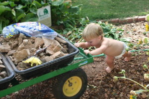 Toddler Wearing only a Diaper in the Garden